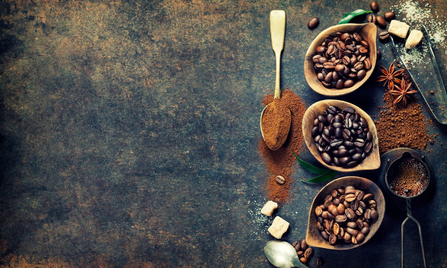 coffee beans, spices and sugars with utensils